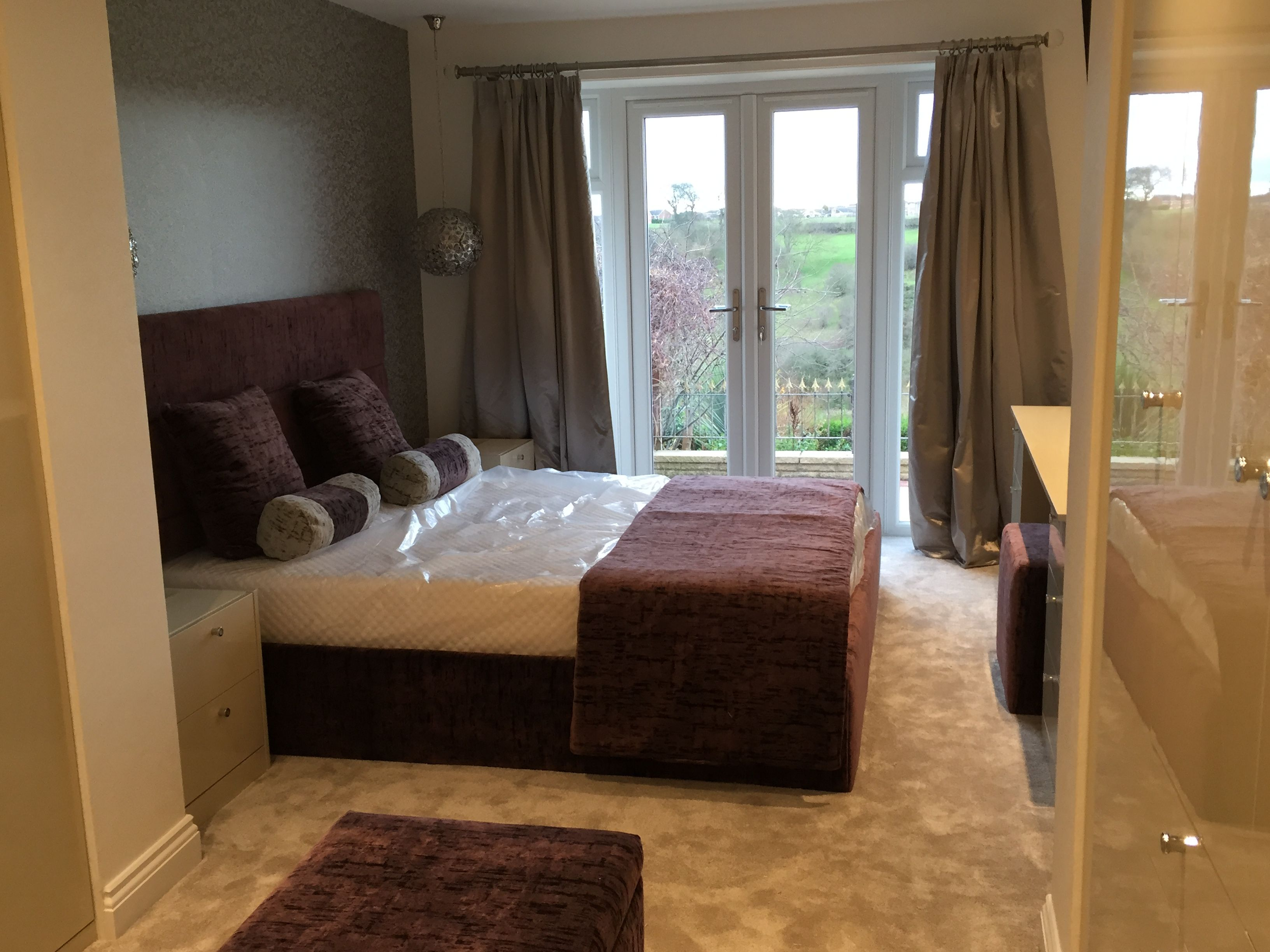 The new extension now expands the master bedroom with french doors leading to a spectacular view.