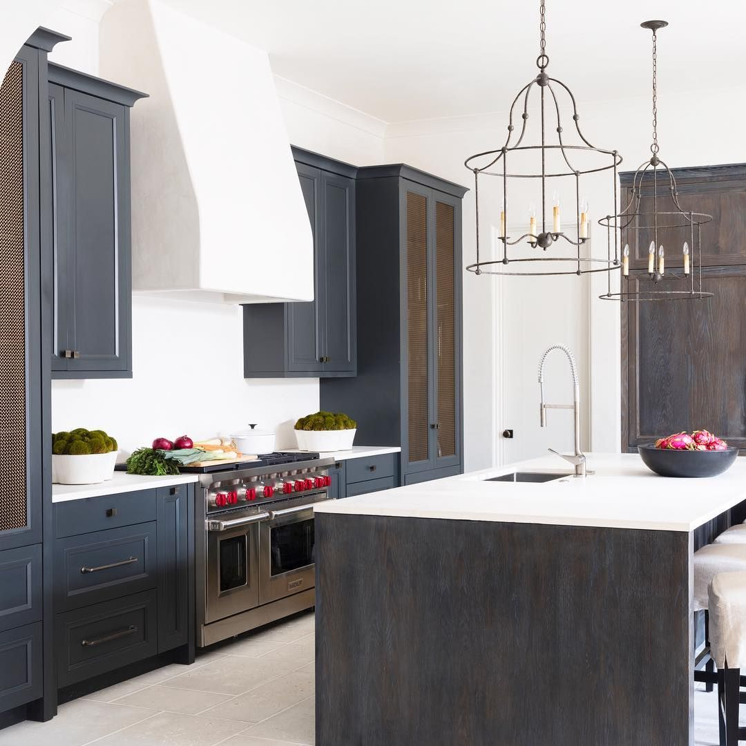 A simple beach house kitchen. Waterfall Island, plaster hood, and ...