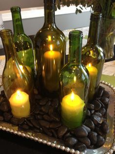 My mom recently sent me a photo of some wine bottles-turned-candle-holding-centerpieces and suggested that we should try making some of our own. The cost to buy them was a little much, so we decide...