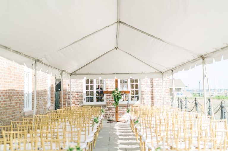 Outdoor ceremony set up at the Historic Rice Mill with wooden cross
