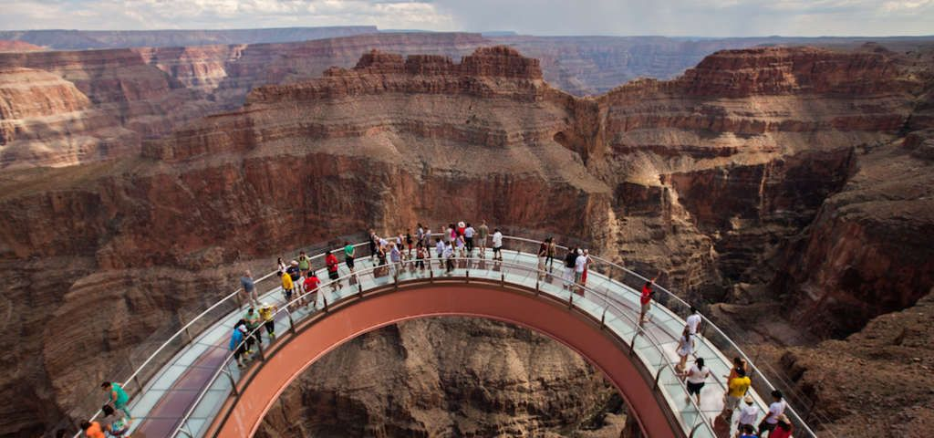 A Glass Bridge Is Suspended 4 000 Feet Above The Colorado River On The Very Edge Of The Grand Can Grand Canyon Tours Grand Canyon Helicopter Grand Canyon South