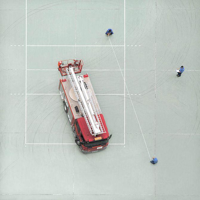 Chan Dick's series of minimalistic photos shows a unexpected view on a fire department taken from a bathroom window in Hong Kong.   via @ossomagazine - #China #HongKong #firefighter #firerescue #firetruck #firelife #firetraining #fireman #firemen #firedepartment #911 #bomberos #bombeiro #firestation #firemen #truck #photographer #birdeyeview #photograph #photo #pic #photooftheday #picoftheday #picture #minimalism #minimalist #square #design #ForInspiration #OsnLikesIt