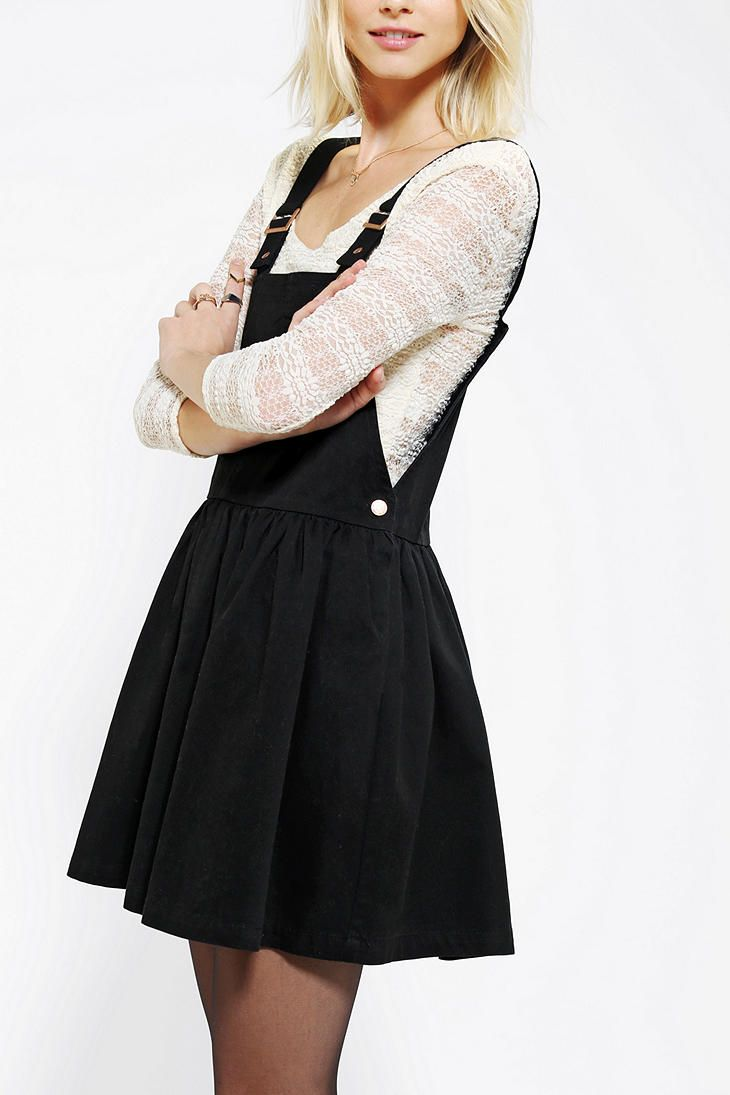 Black Overall Dress Thinking about an over...