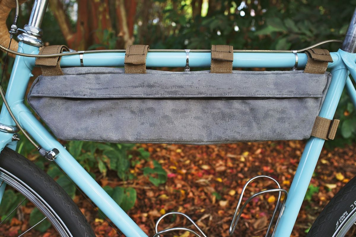 A classically-styled waxed canvas tangle frame bag built for lugged steel Randonneuring and light touring bike.
