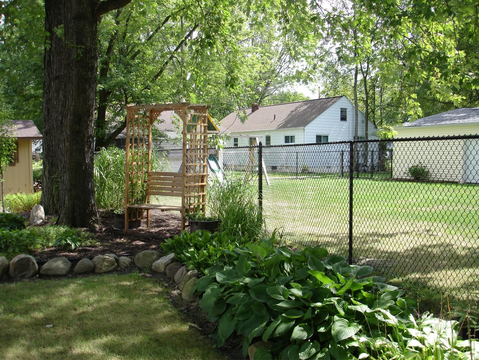 black chain link fence with wood black vinyl chainlink fence