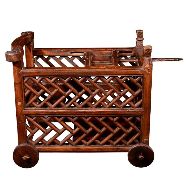 "Carved Rosewood child's baby carriage with moveable tray top and pegged articulating wheels, China late 19th century. Height 20.5"" Width 17.5"" Length 25"""