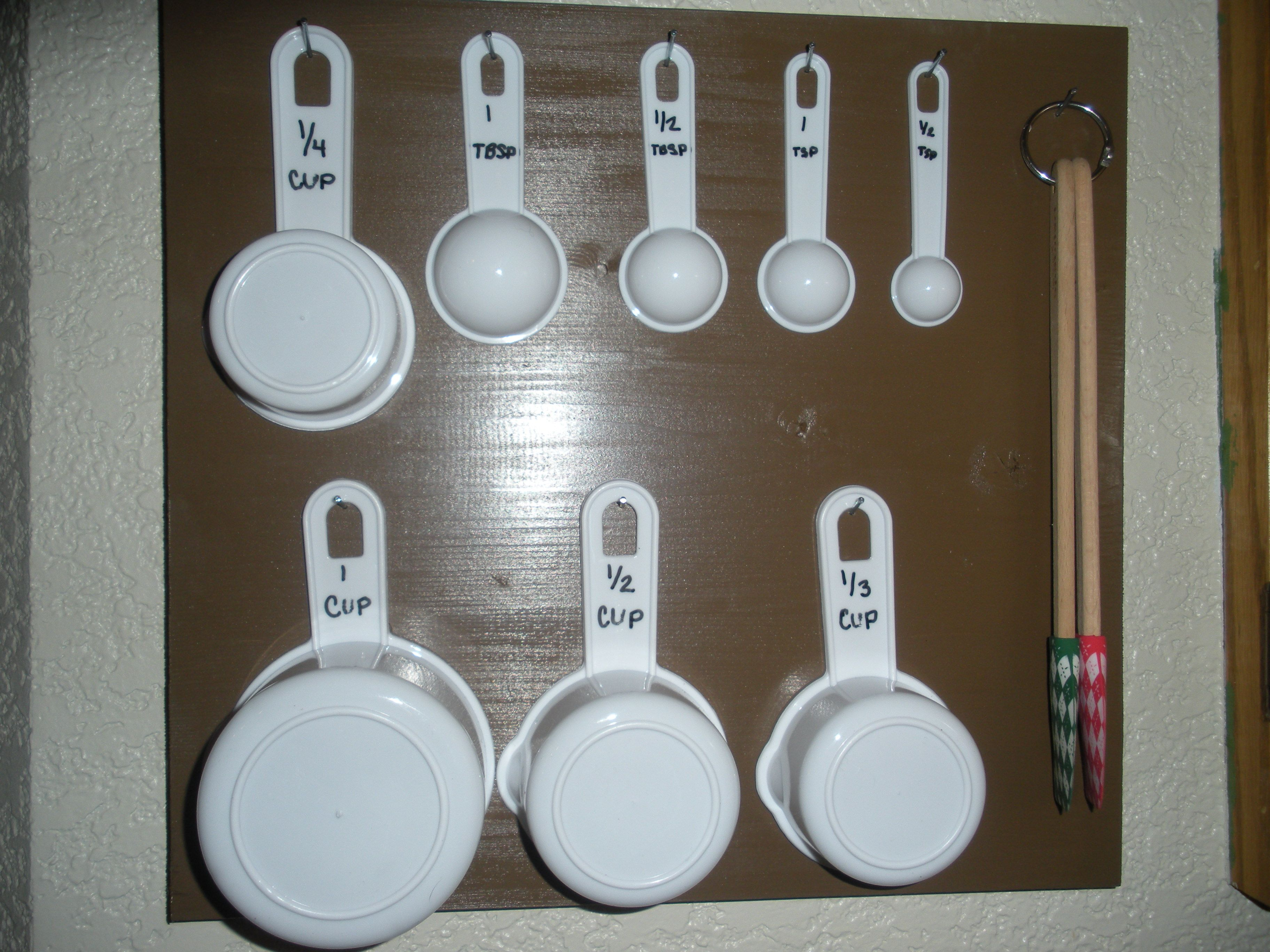 Portion board! this makes things easily available & cute! Just got a piece of wood, paint, measuring cup set (just for this so they don't get lost or mixed up), some nails, & a picture hanger for the back and TADA!!