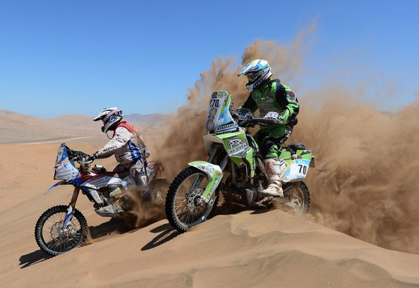 Diego Demelchori of team RPM Kawasaki and Simon Pavey of team Delta Kunstaffe Husqvarna UK competes in stage 13 from Copiapo to La Serena during the 2013 Dakar Rally on January 18 in Copiapo, Argentina.
