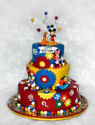The figurines on this cake were provided by the client. The cake is done in gears and primary colors to match the figurines. The Birthday Boy is a big fan of Mickey Mouse Clubhouse.
