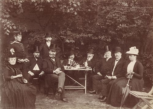 Group of people in Lysekil park, Sweden  A group of people at a drink table in Lysekil park. Calla Curman, wife of Carl Curman, to the left? 1880s