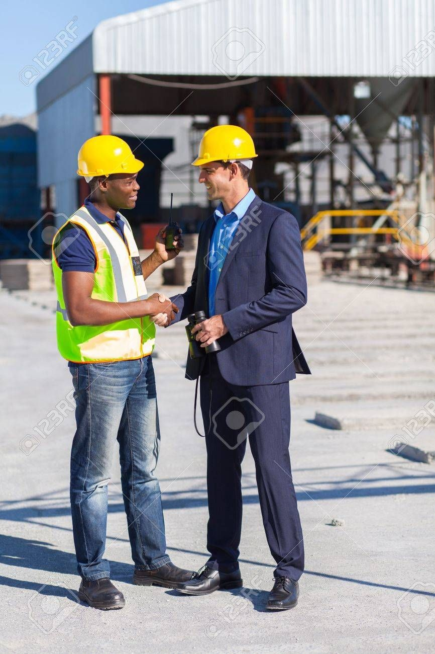 construction manager and worker handshake on site , AD,