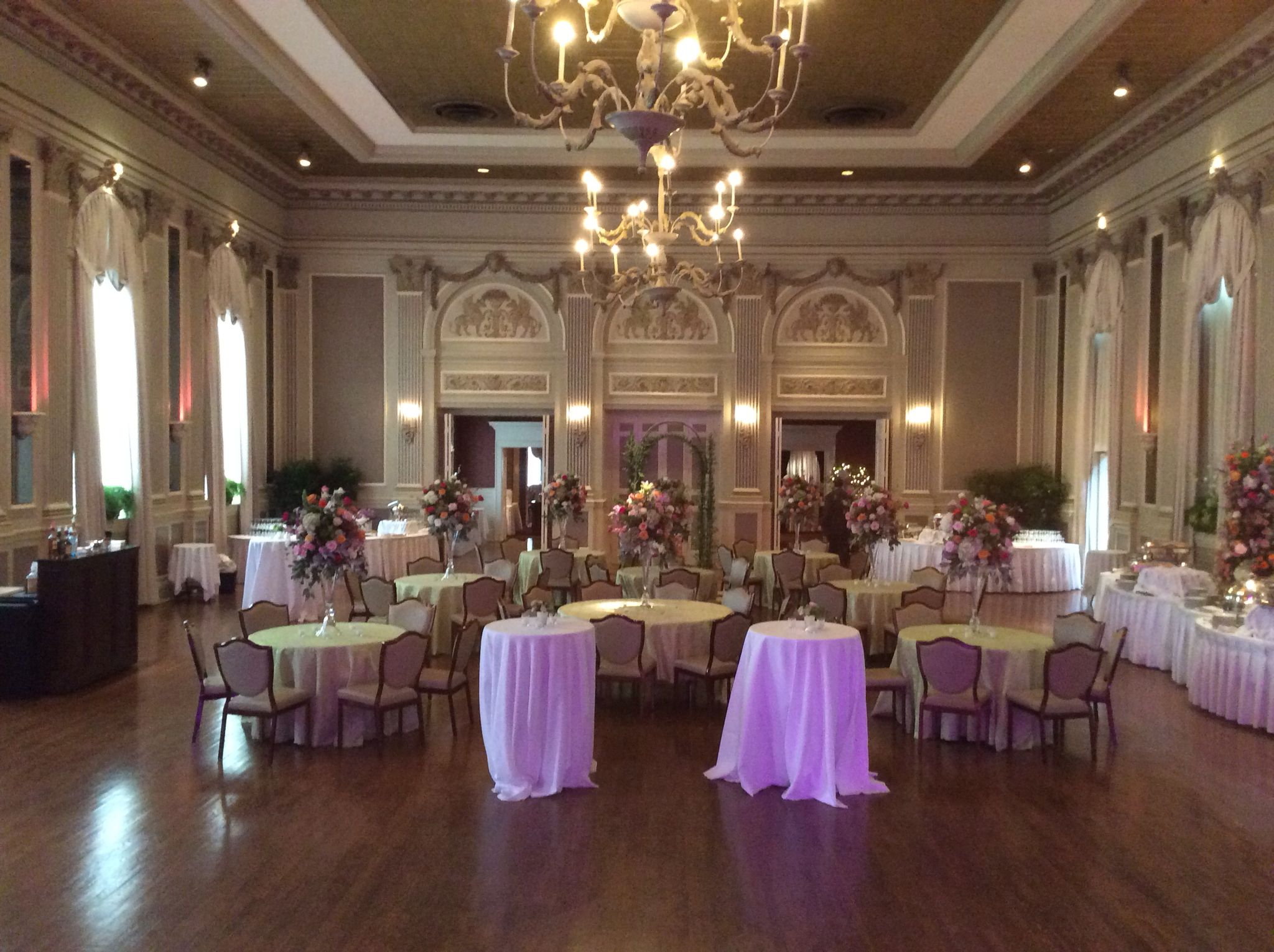 Cocktail Style Reception With Tall Arrangements On Seated