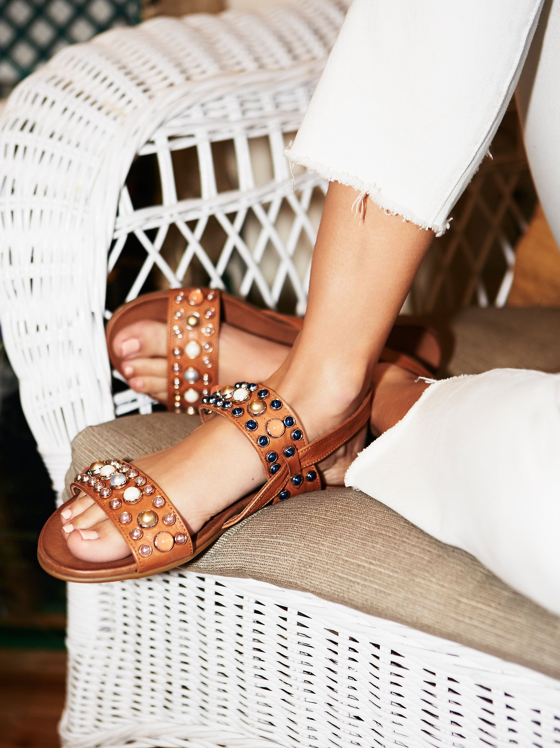 Slip-on leather sandals embellished with allover stone detailing. Adjustable ankle strap in back and a treaded rubber sole.