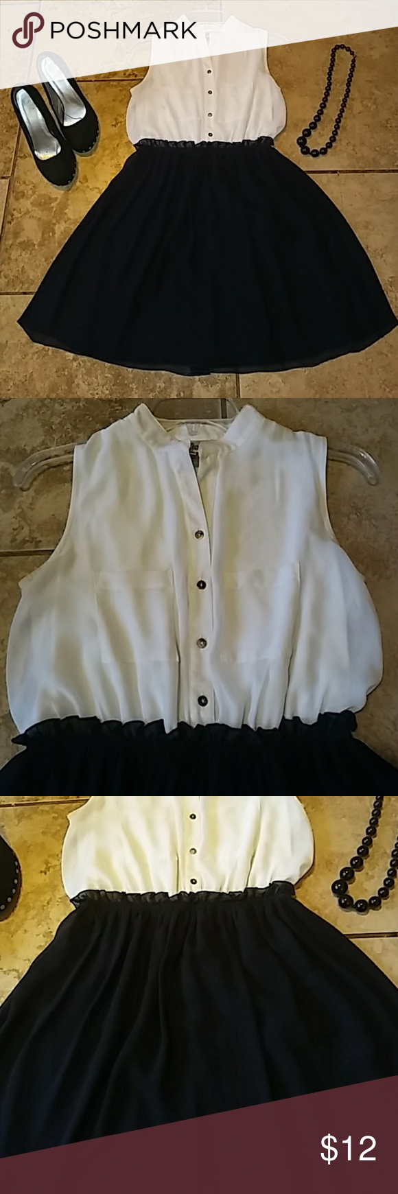 Sweet storm high waisted sleeveless dress sz.m Like new womens size m sleeveless high waisted sweet storm brand dress. It has pockets on the front and buttons. The high waist in stretchy and it has a built in slip. It is light cream and navy blue .so chic. Thanks I love to bundle and deal And shipping is super fast Sweetums Dresses Midi