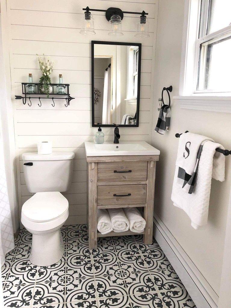 Farmhouse Style Bathroom With Shiplap Walls Ceramic Tile Flooring Wood Vanity And Ne Small Farmhouse Bathroom Bathroom Farmhouse Style Bathroom Design Small