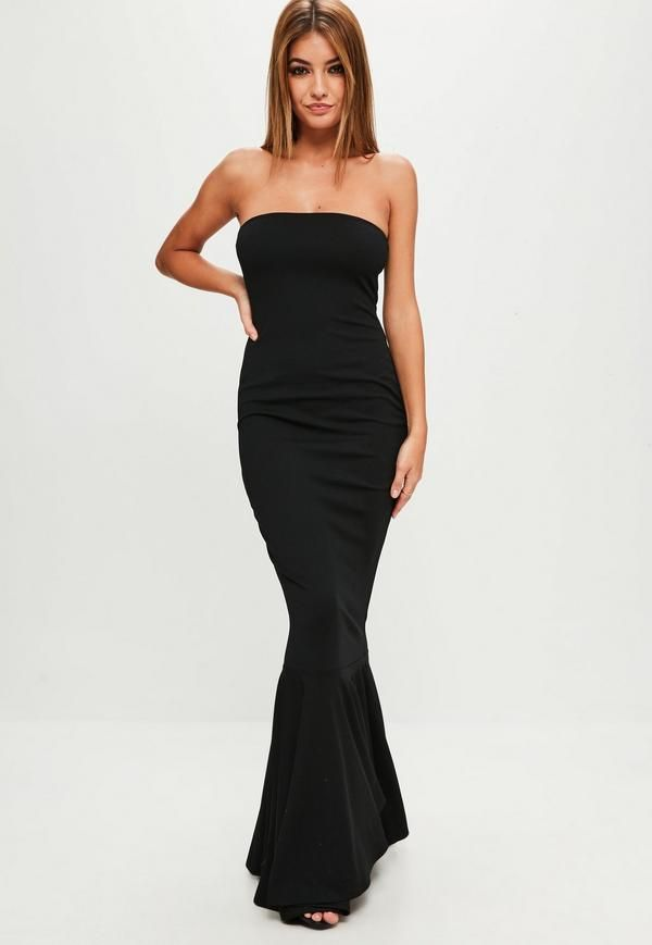 A bandeau style dress in a black hue with maxi length and fishtail ...