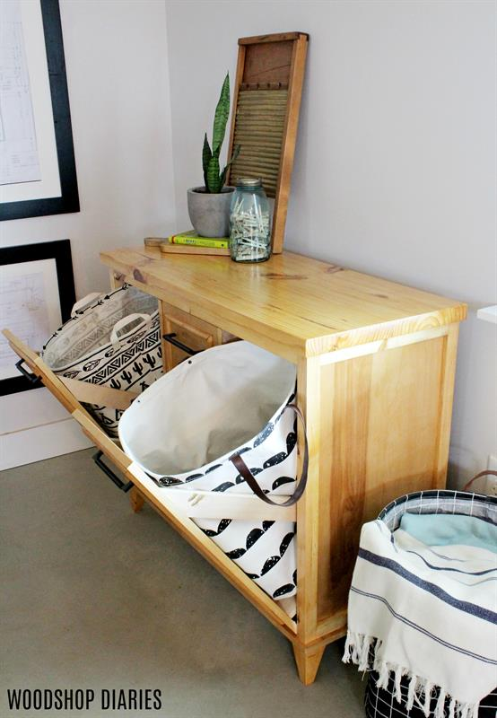 This laundry cabinet provides storage, a place to hide your dirty clothes, and a surface to fold towels on when they come out of the dryer. It's the perfect addition to any laundry room, but skip the tilt out doors, and it also makes a great console cabinet for a dining or living room, or entryway.