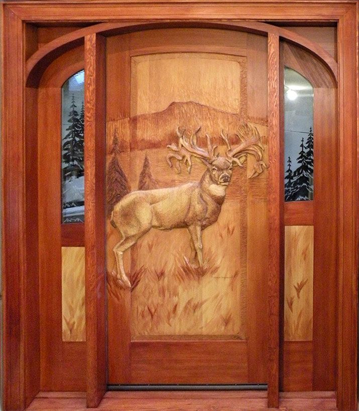 Hand carved deer entry door pretty sure at a mere 16 800 for Hand carved wood doors