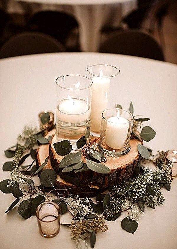 rustic wedding centerpiece ideas with candles and greenery #emmalovesweddings #w... Check mor...