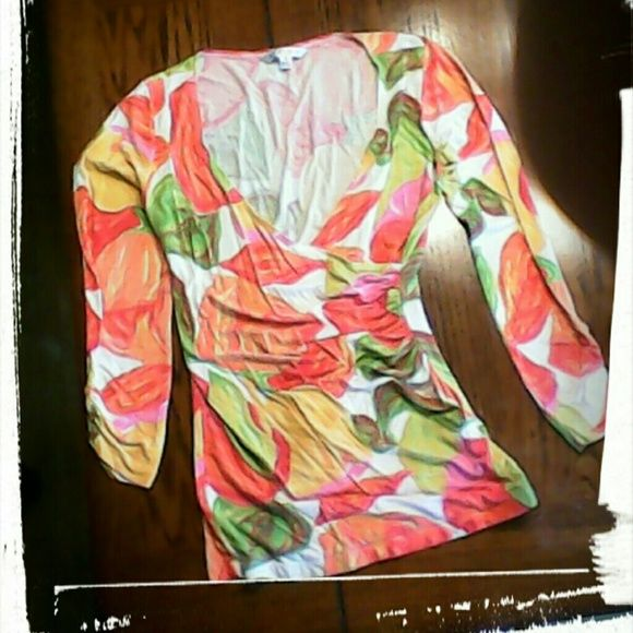 Long sleeve floral print top Very colorful, v neck. Tulips with leaves. Like new. Mostly rayon, some spandex. CAbi Tops
