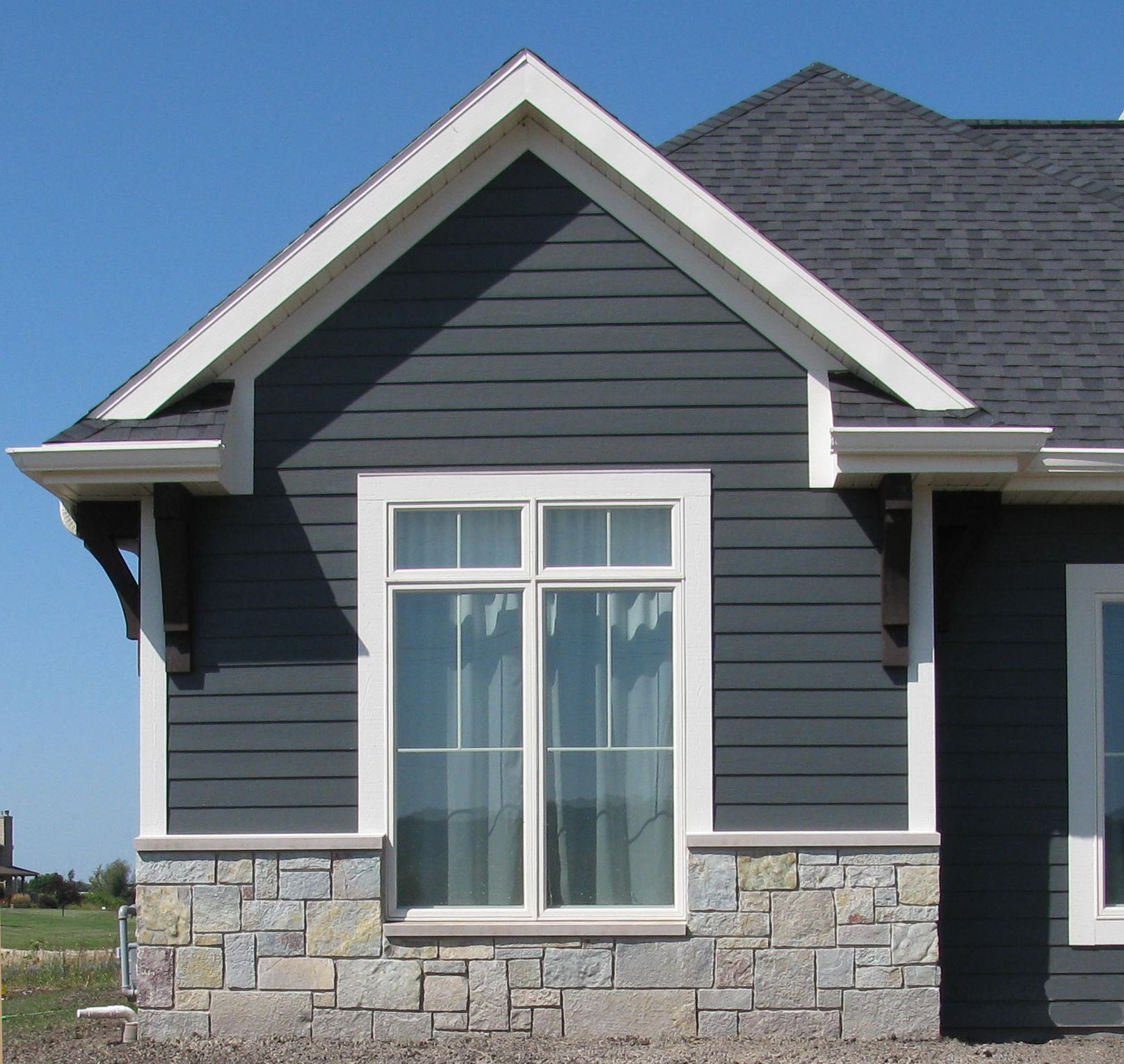 Castle stone exterior siding on home google search for Blue siding house