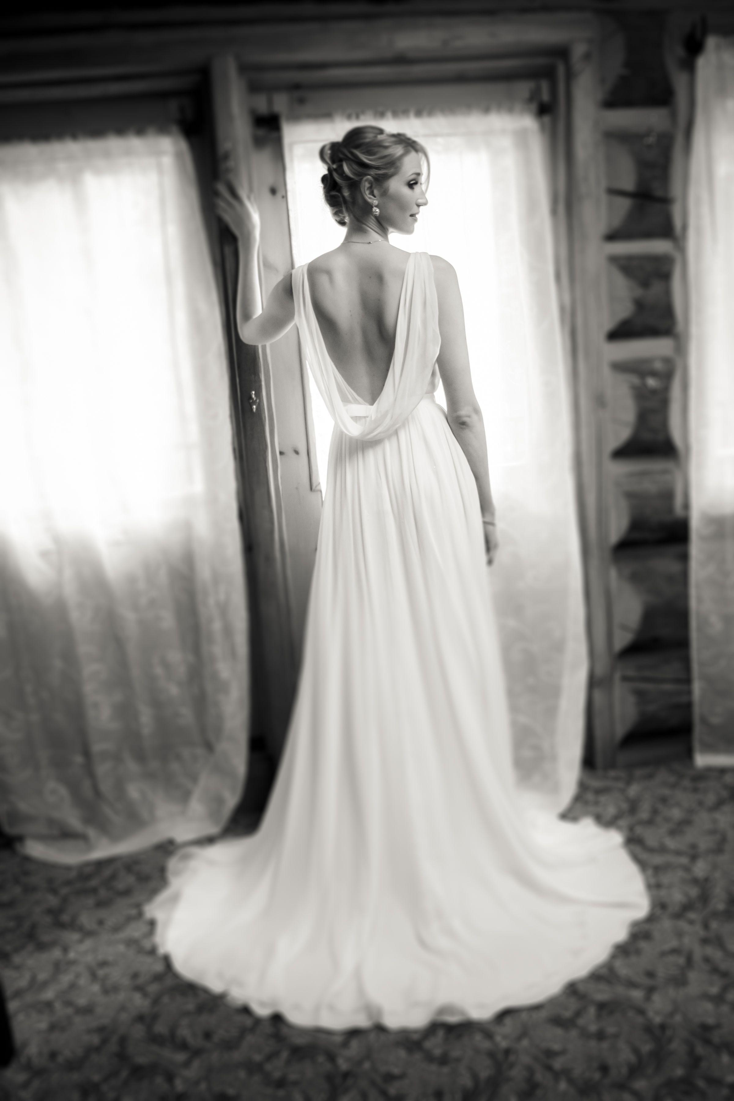 Low back wedding dress. http://www.pronovias.us/. Loose wedding hair ...