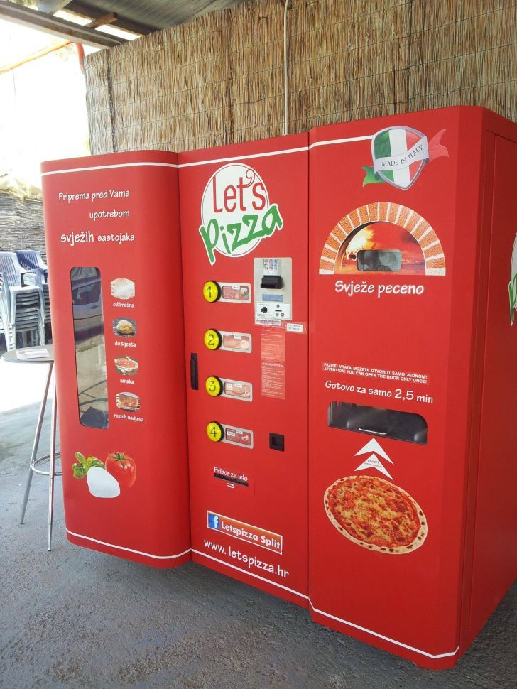 This is a pizza vending machine in Croatia. You pick the toppings and it bakes it for you right there!