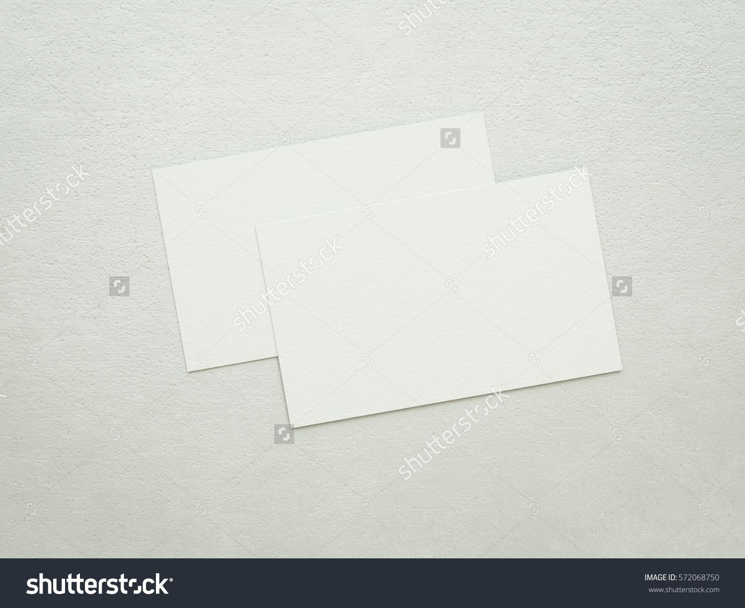 Two blank business cards mock-up, clean white paper texture ...