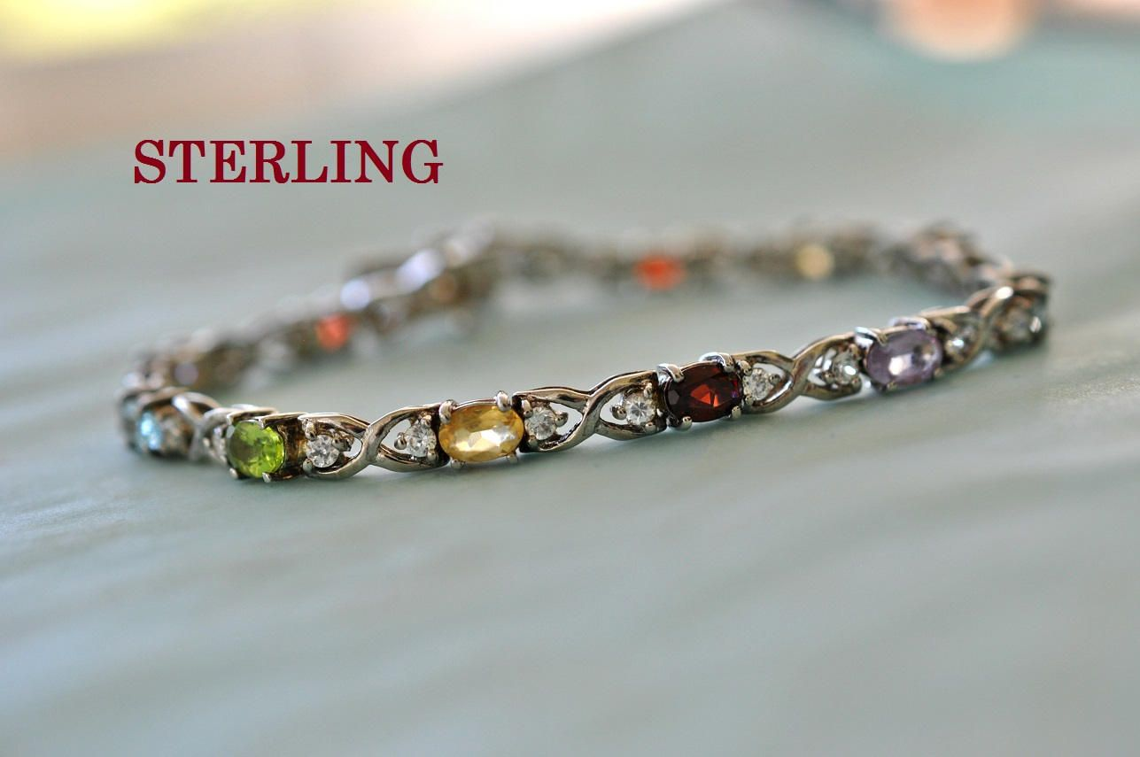 Sterling Silver bracelet with three stones #619