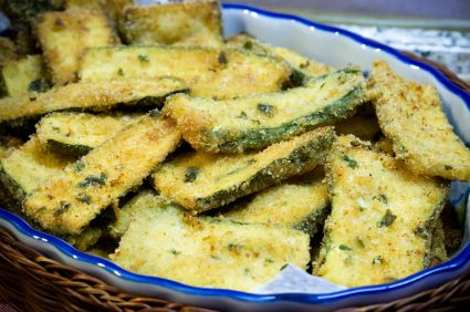 Zucchini fries: Dip in egg and sprinkle with bread crumbs. Bake at 425 for 30 minutes----YUM!