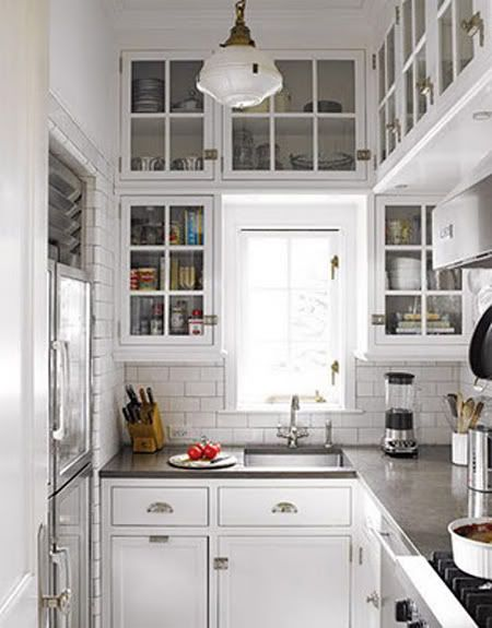 tiny kitchen, great use of space - I like the high cabinets, it makes the kitchen seem less cramped