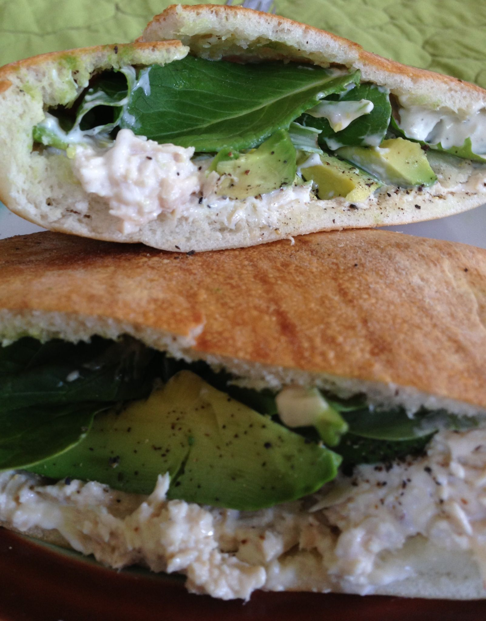 I just made this sandwich: tuna, avocado, spinach, a little creamy Caesar dressing, fresh black pepper, all inside a fresh baked pita (from Petra in SLO) and now I'm gonna eat it! #zormasa