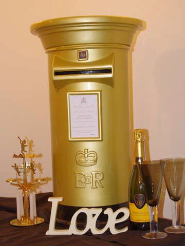 Gold 'bling' post box from yourweddingpostbox.co.uk. Hard to choose between this and traditional red but this won the day. (Might place in a slightly less bright corner!)