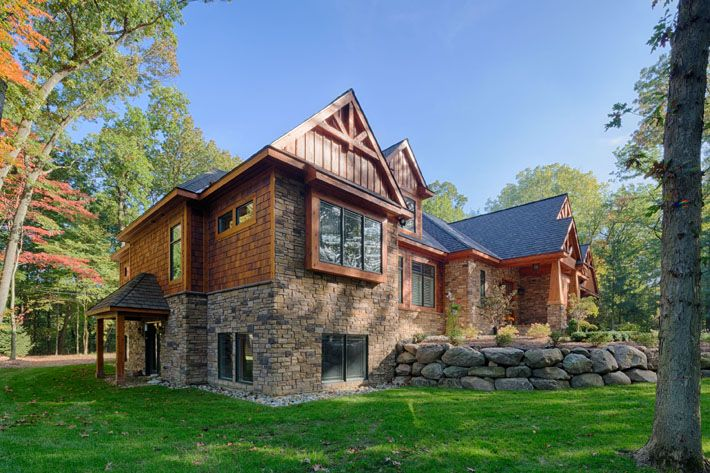 what a gorgeous rustic home in the woods with landmark stone