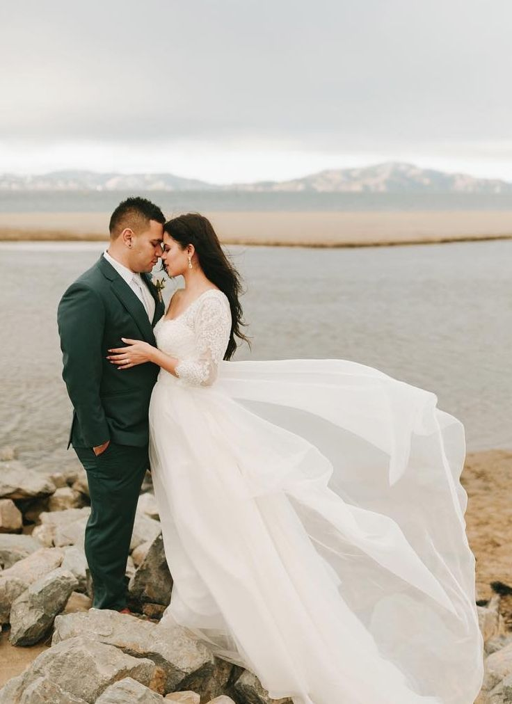 David's Bridal bride in a Long Draped Ball Gown Wedding