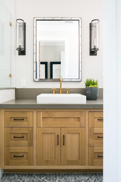 Wood Washstand With Gray Quartz Countertop And A Vessel Sink