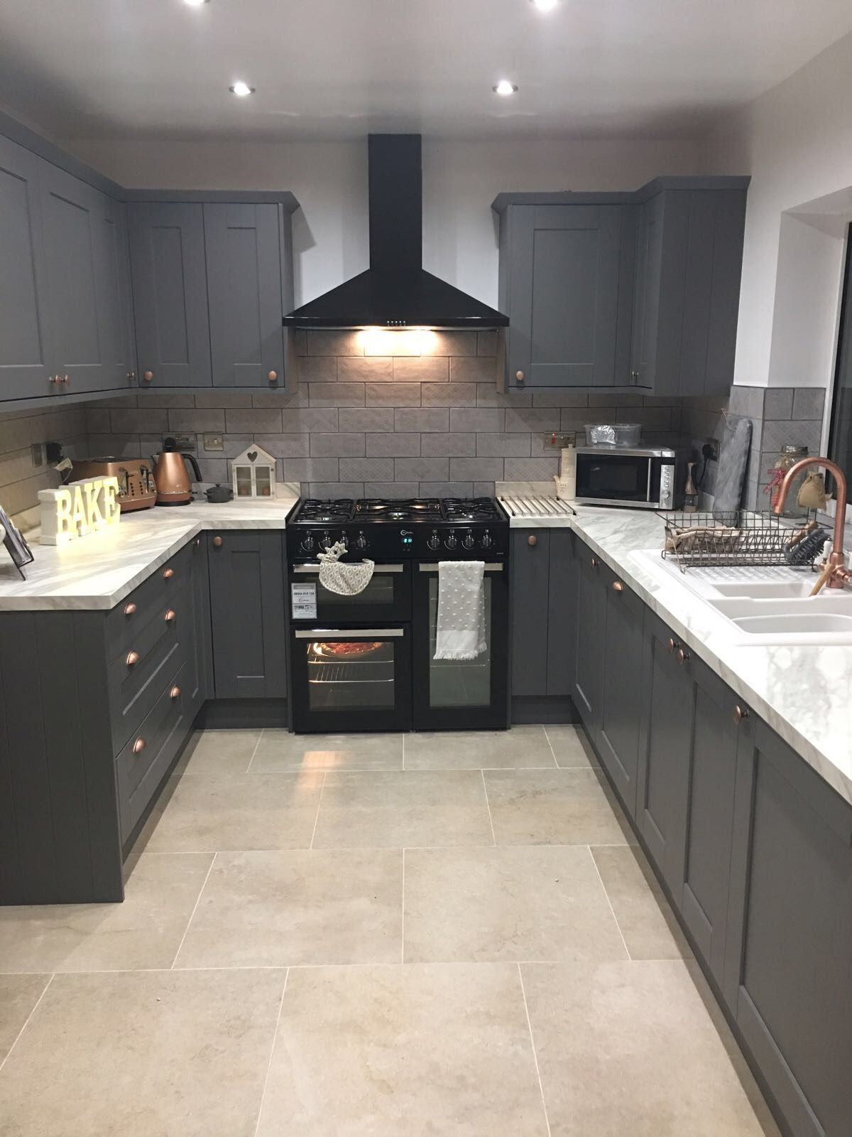 White Marble Effect Worktops Look Great In Our Fairford Graphite Kitchen This Was Designed By Grey Kitchen Designs Modern Grey Kitchen Latest Kitchen Designs