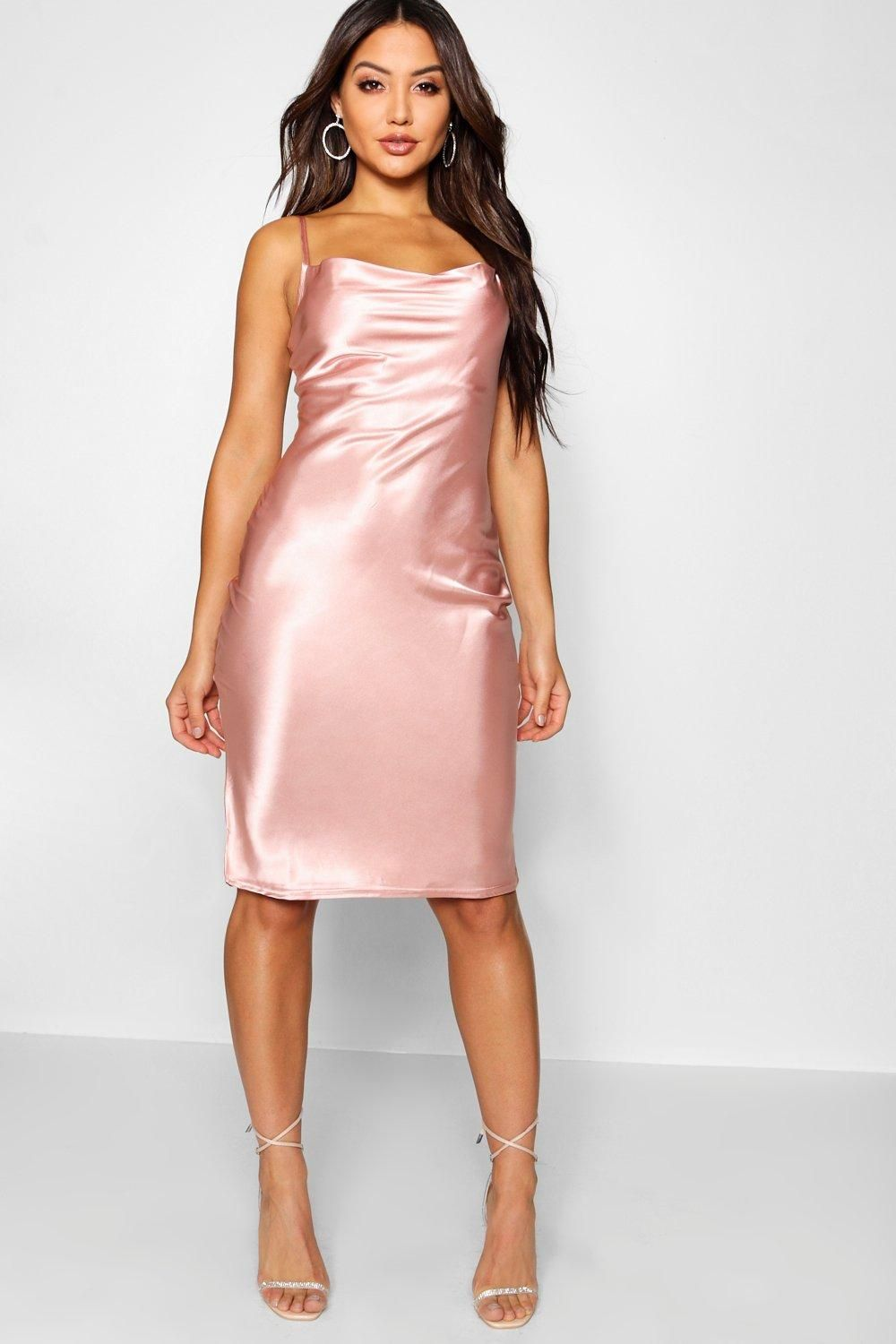 2c52cab624271 Click here to find out about the Satin Cowl Neck Midi Slip Dress from  Boohoo, part of our latest Dresses collection ready to shop online today!