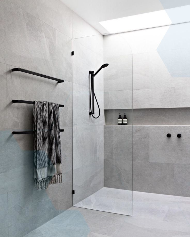 Ensuite bathroom with skylight grey tiles black taps and frameless glass Ensuite bathroom Ensuite bathroom with skylight grey tiles black taps and frameless glass Ensuite...