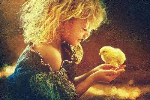 Yellow happiness: A girl with a chick. Photoart by Karina Kiel