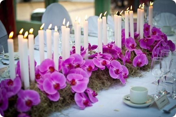 Candles running down the table with moss + moth orchids. So lovely and romantic! (BUT! Helpful hint: If you're getting married in Corpus Christi city limits, candles be encased in glass) #pantone2014