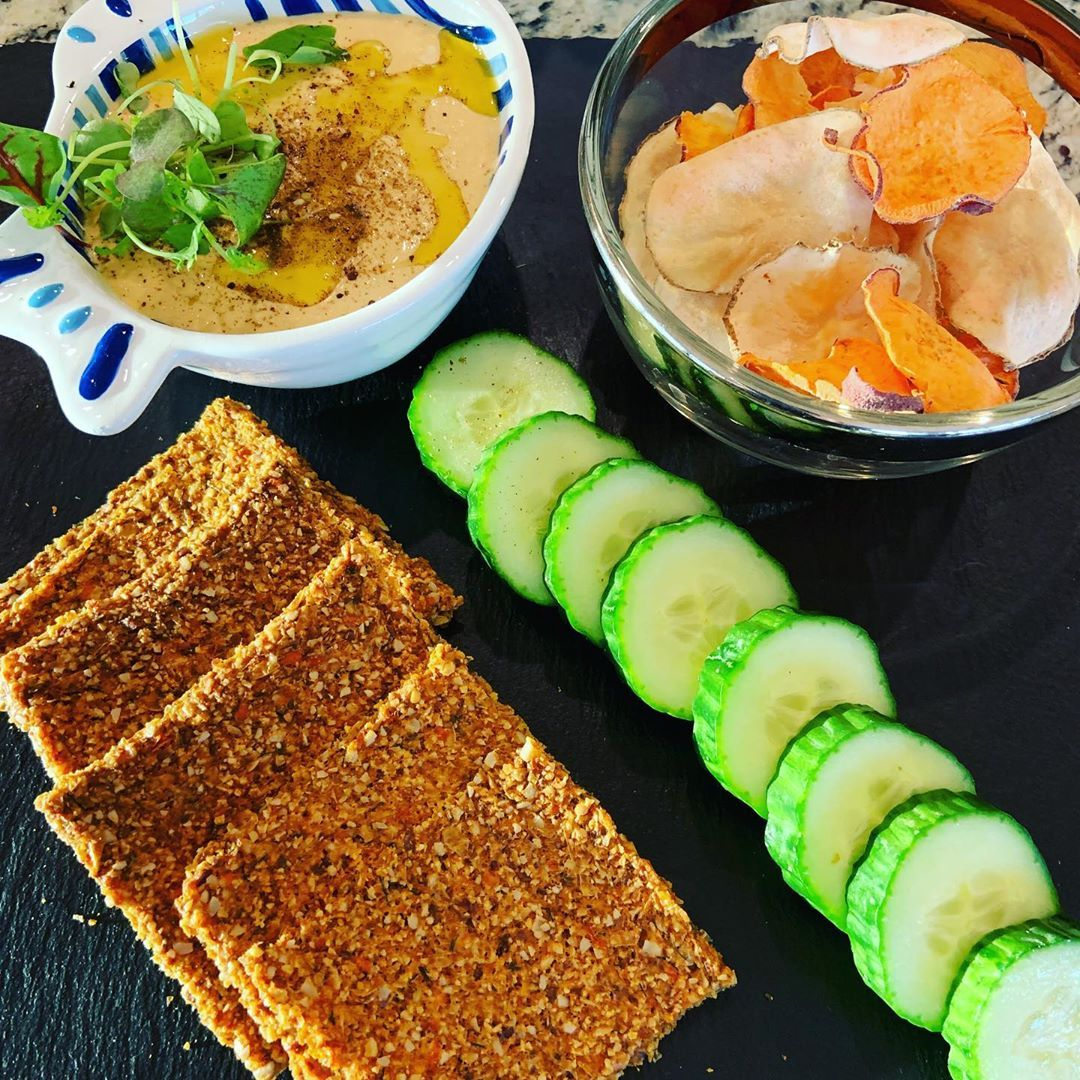 The snacks amp; appetizers at our Cleanse: Red Bell pepper Hummus with cucumber slices, medley of dehydrated potato chips and sunflower crackers. Delish!..#raw