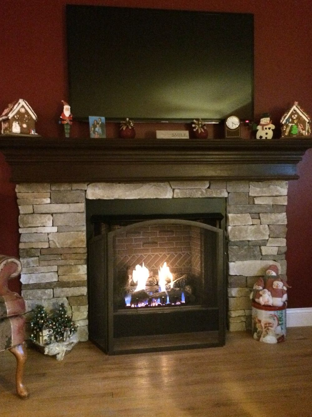 completely installed gas fireplace with custom stone mantle top