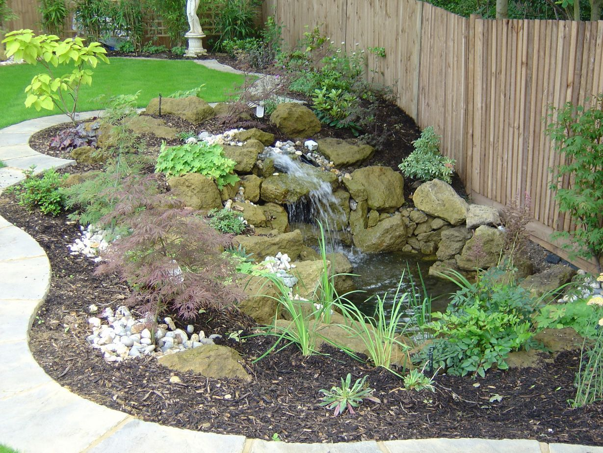 Garden and patio simple and easy diy backyard landscaping for Rock ponds designs