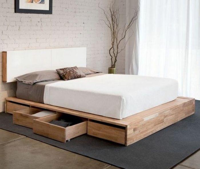 lit avec tiroir de rangement en bois clair et tapis gris anthracite chambre a coucher parentale