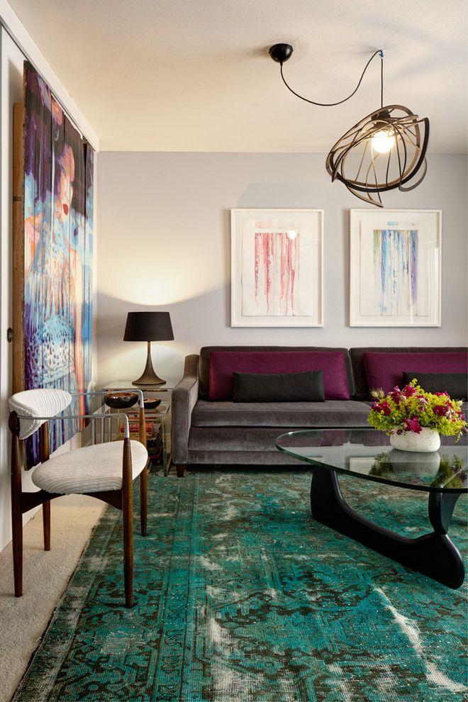 Glam eclectic living room area featuring aqua