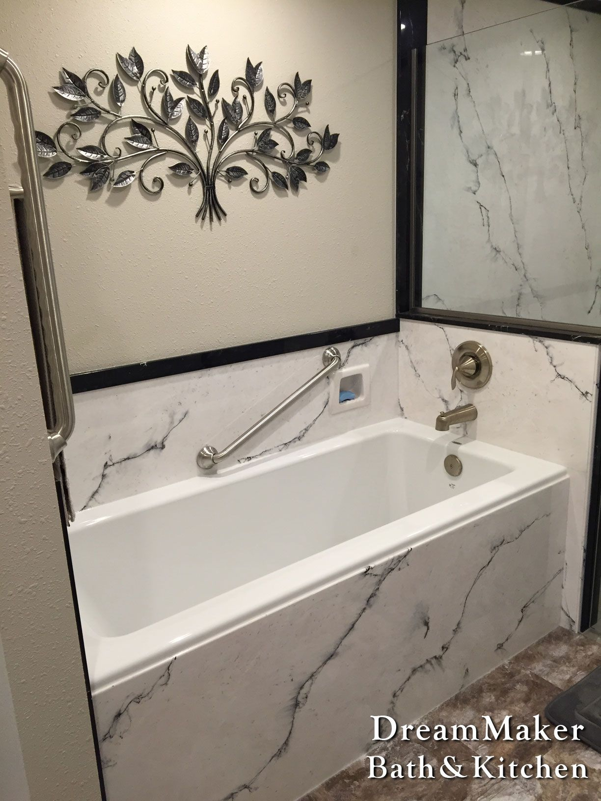 White cultured marble tub surround with grab bars