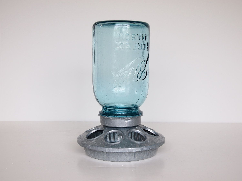 A mason jar upcycled into a bird feeder very cute idea