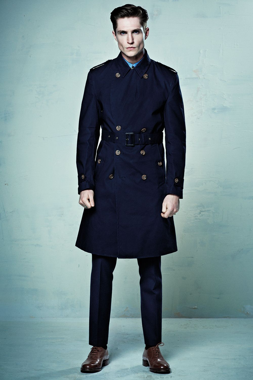 A classic trench coat in navy blue with all the features you would ...