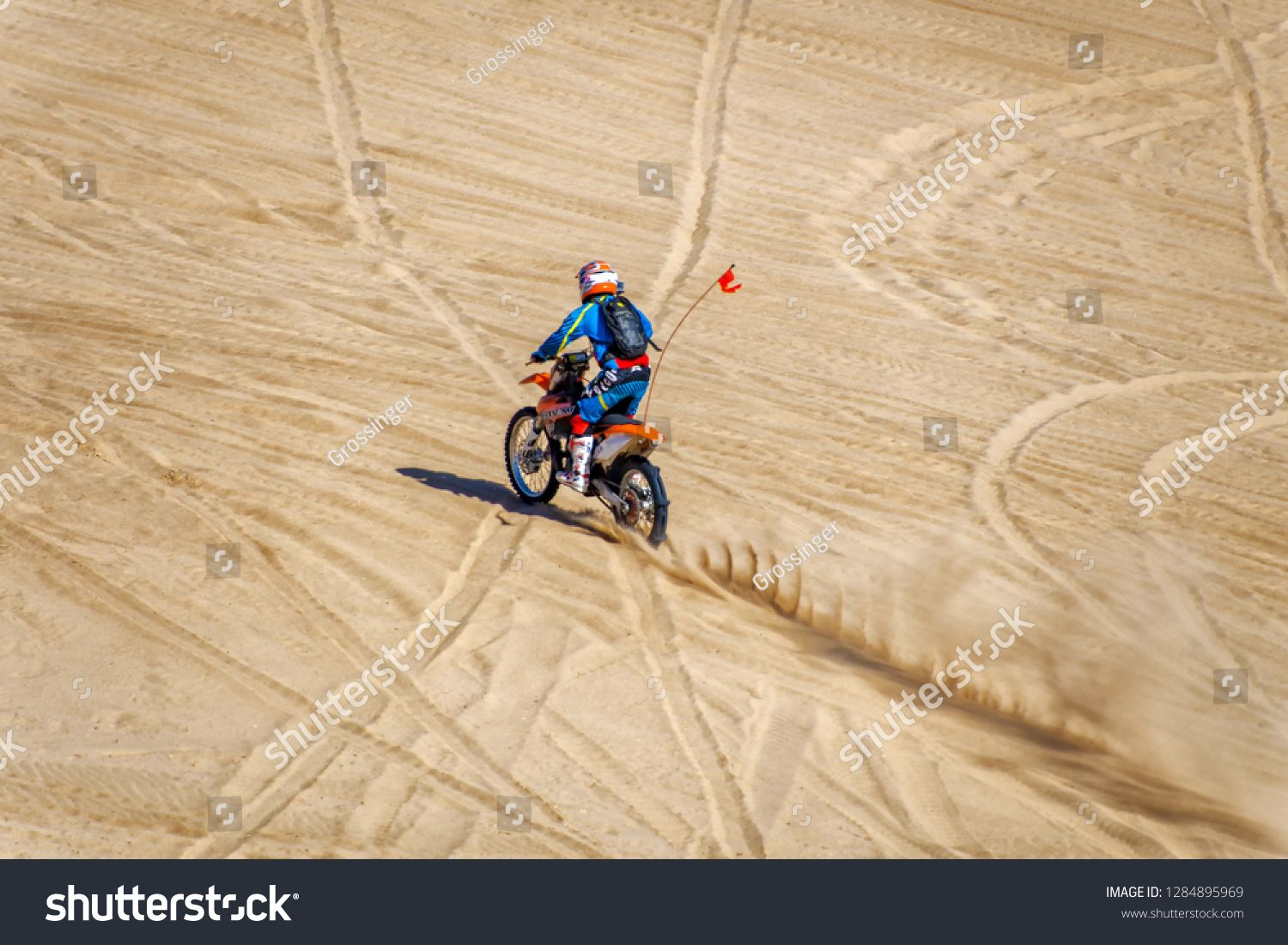 Dirt Bike Roff Road Motorcycle Riding A Sand Dune In The Imperial